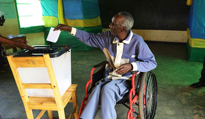 Person with disability voting in Rwanda.