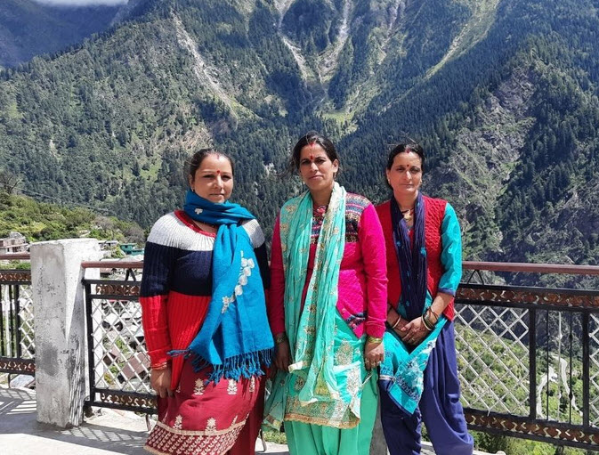 Image of three female health workers in a rural part of India